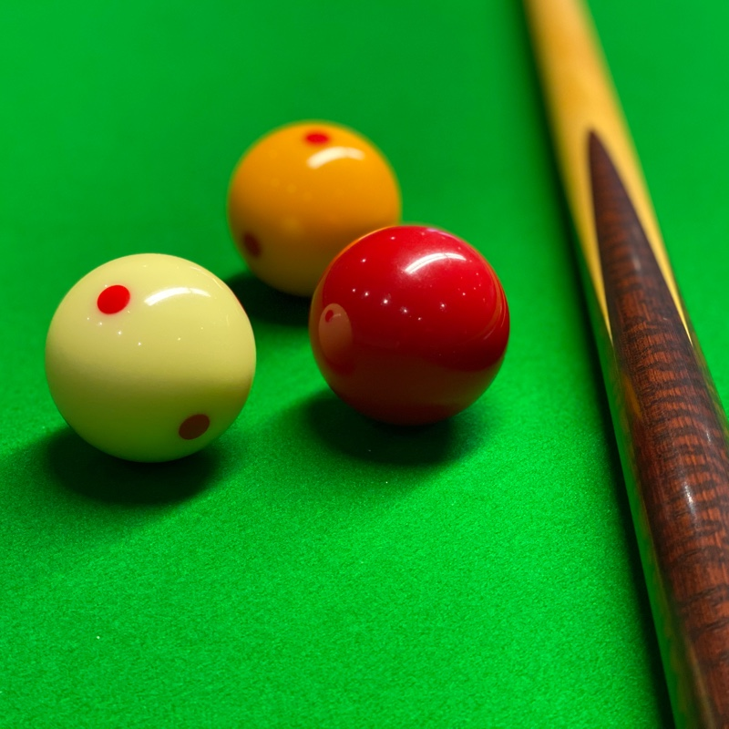Billiard balls and cue