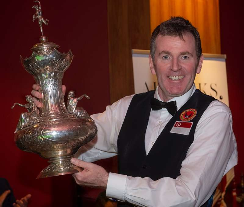 Peter Gilchrist lifts the John Roberts Trophy